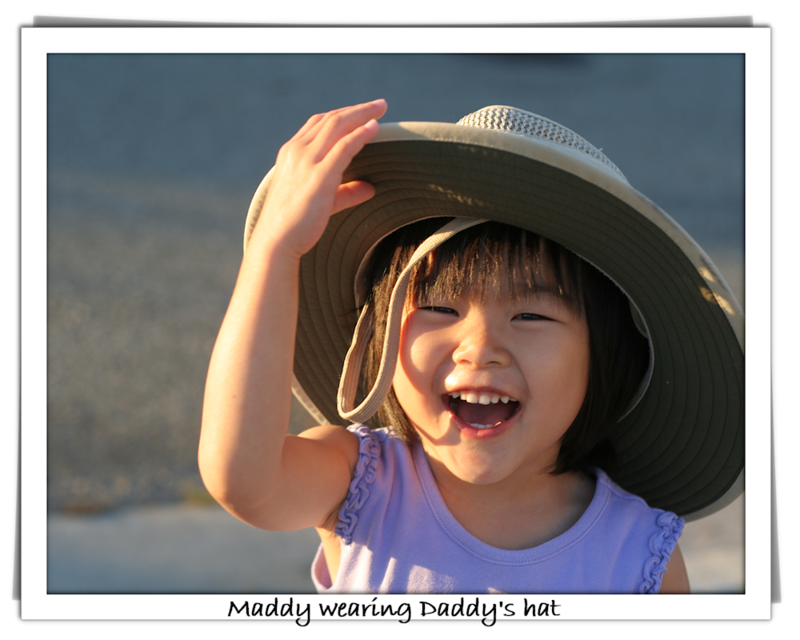 Maddy wearing daddy hat-blog