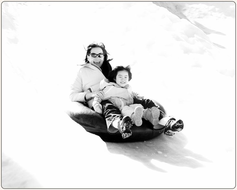 Mommy and maddy bw sledding