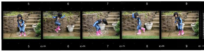 Maddy splashing in rain boots