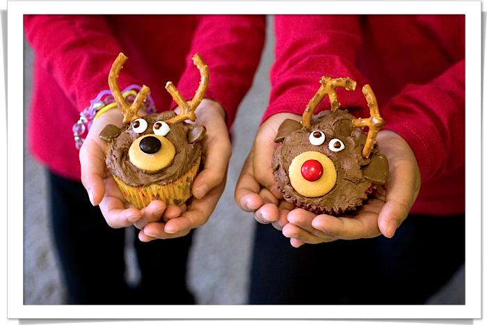 1 girls holding reindeer cupcakes