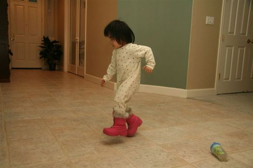 Maddy strutting in Gwen's pink snow boots